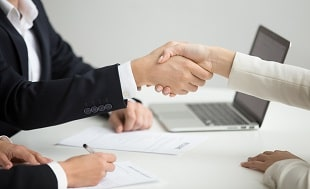 HR handshaking successful candidate getting hired new job closeup.