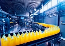 Beverage factory interior Conveyor with bottles for juice