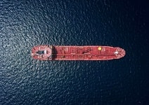 aerial view of ship with containers in sea.